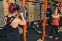 Two Female Crossfit Trainers Working Together Royalty Free Stock Photography