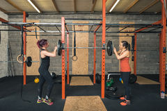 Two Female Crossfit Trainers Working Together Stock Photography