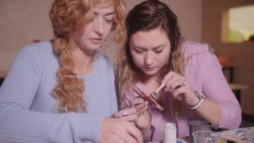 Two female decorators make figurines. Craft workshop. Two female decorators make figurines. Craft workshop stock footage