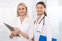 Two female doctors Stock Images