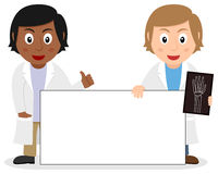 Two Female Doctors with Blank Banner Royalty Free Stock Image