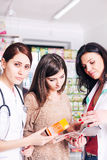 Two female doctors explaining a product to client Stock Photography