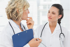 Two female doctors with medical reports Royalty Free Stock Image