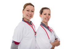 Two female doctors smiling to the viewer Stock Photo