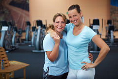 Two female employees in gym Royalty Free Stock Photo