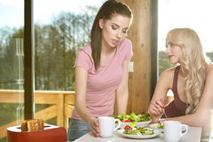 Two Female Enjoying Breakfast At Home Together Stock Photography
