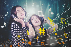 Two female enjoying music together Royalty Free Stock Photo