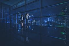Two female entrepreneurs looking at a city Stock Photo