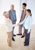 Two female executives shaking hands on deal Stock Images