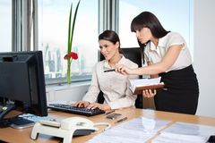 Two Female Executives Working In Office Stock Photo