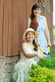 Two female  florists. Working in the garden Royalty Free Stock Photography