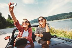 Two female freinds take a selfie photo during their auto travel royalty free stock photo