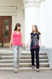 Two female friends. Walking outdoor Royalty Free Stock Photo