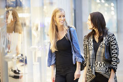 Two Female Friends With Bags In Shopping Mall Stock Photo