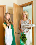 Two female friends coming home Royalty Free Stock Image
