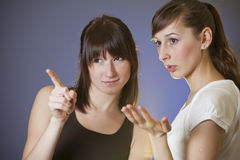 Two female friends discussing Stock Photography