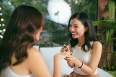Two female friends do a manicure. The concept of hand care stock photography