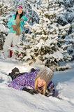 Two female friends enjoy snow winter countryside stock photography