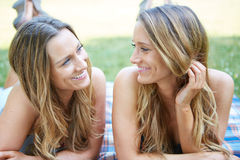 Two Female Friends. Enjoying Picnic Together in Nature Stock Photo