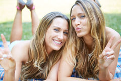 Two Female Friends. Enjoying Picnic Together in Nature Stock Images