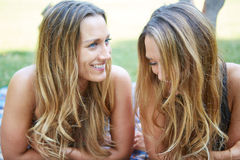 Two Female Friends. Enjoying Picnic Together in Nature Stock Image