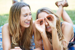 Two Female Friends. Enjoying Picnic Together in Nature Royalty Free Stock Images