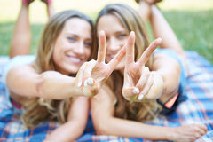 Two Female Friends. Enjoying Picnic Together in Nature Royalty Free Stock Photography