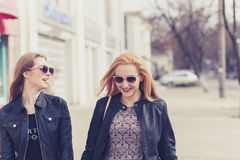 Two female friends enjoying a walk in sunny wheather Royalty Free Stock Image