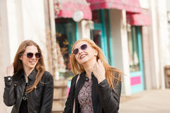 Two female friends enjoying a walk in sunny wheather Royalty Free Stock Photos