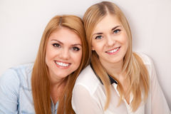 Two female friends having fun Royalty Free Stock Image