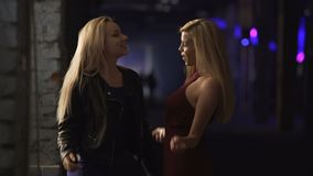 Two female friends having fun at party, moving to music on dance floor, laughing. Stock footage stock footage