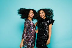 Two female friends having fun in studio. With hair blowing Stock Photo