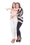 Two female friends isolated Royalty Free Stock Photos
