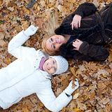 Two female friends lying Royalty Free Stock Photography