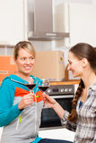 Two female friends moving in an apartment royalty free stock photos