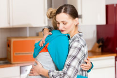 Two female friends moving in an apartment Royalty Free Stock Image