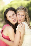 Two Female Friends Pulling Faces Together Royalty Free Stock Image