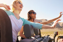 Two Female Friends On Road Trip In Back Of Convertible Car Royalty Free Stock Images