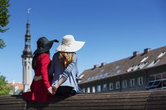 Two female friends tenderly holding hands together Royalty Free Stock Images