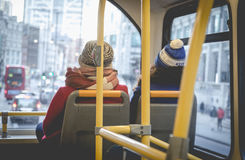 Two female friends traveling on the doubledecker public transpor. Two female friends traveling on doubledecker public transport in London via Liverpool Street Stock Photography