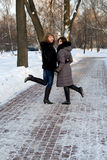 Two female friends walking in park Royalty Free Stock Photos