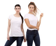 Two female friends on white background Royalty Free Stock Image