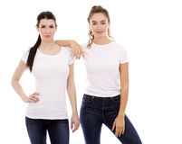 Two female friends on white background Stock Photo