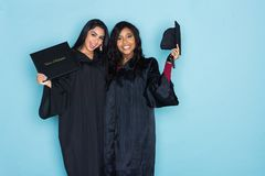 Two Girls Graduation From School Stock Photography