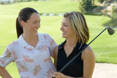 Two female golfers laughing Stock Image