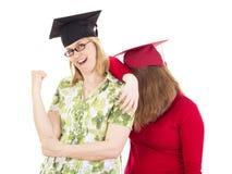 Two female graduates Royalty Free Stock Photo
