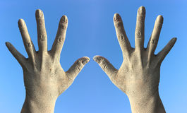 Two female hands in the dirt and dust from the splayed fingers a Royalty Free Stock Photos