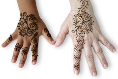 Two female hands with henna tattoos. Two female hands of different human races and ages, with henna tattoos, symbol of Racial Harmony.Isolated on white royalty free stock photography