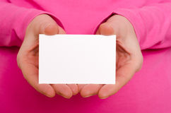 Two female hands are holding a business card. Two female hands are holding a blank business card Royalty Free Stock Photography