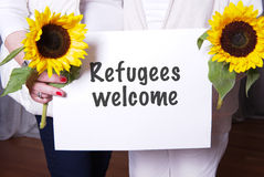 Two female helpers welcome refugees Royalty Free Stock Photos